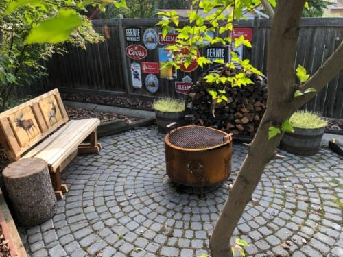 Pitboss Custom Pit with Grate Lid and Fire Ring as a Backyard Centrepiece